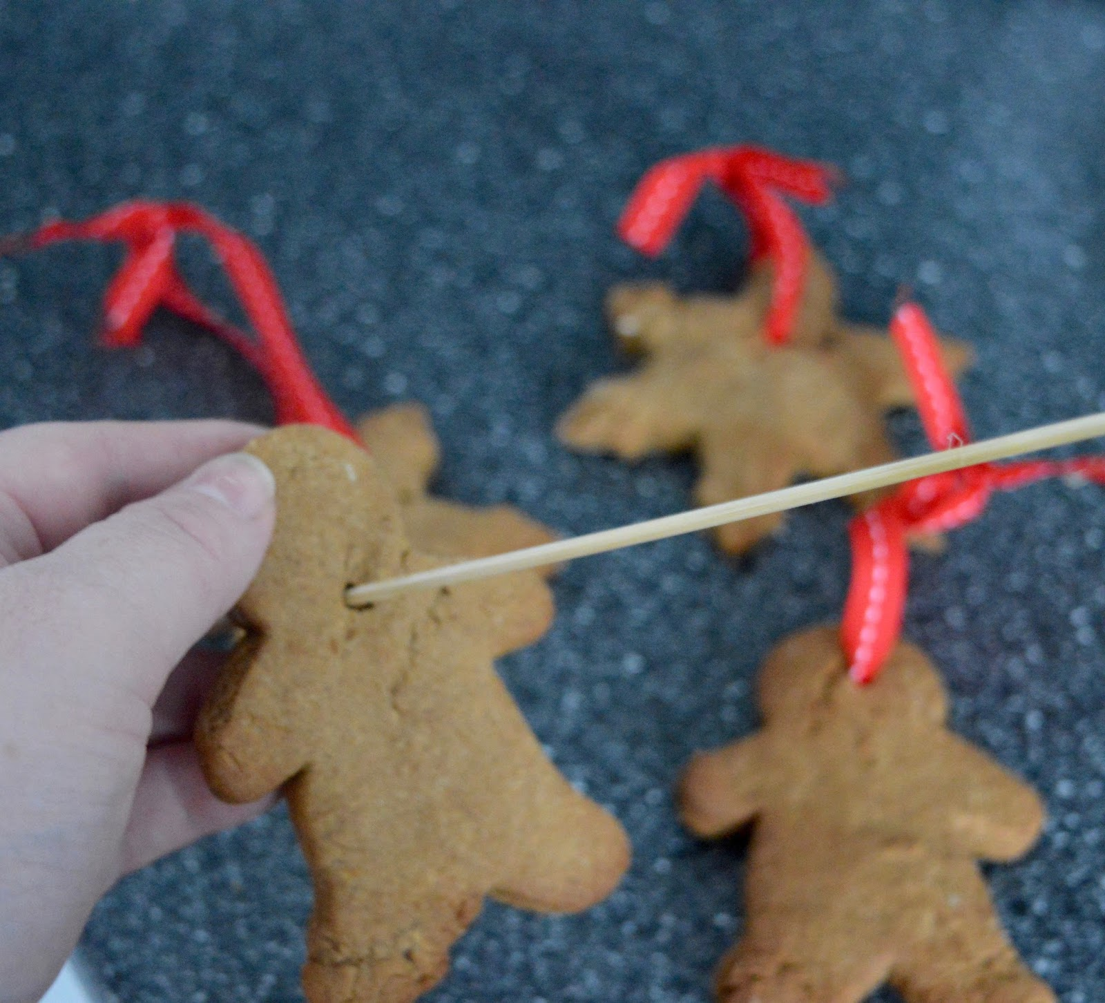 Easy Homemade Gingerbread Christmas Tree Decorations | A Recipe - threading ribbon
