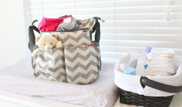 Your cloth diaper questions answered by real moms: What tips and tricks do you have to make cloth diapering easier? Survey results- Bumgenius diapers in a Hop Skip Go grey chevron diaper bag