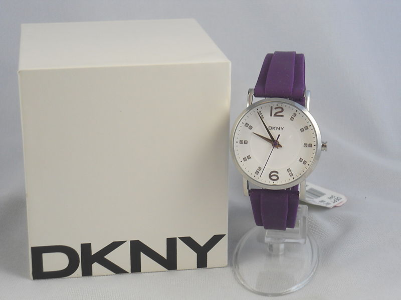 3aa2aa96dd5 DKNY NY8155 Lady Purple Rubber Watch This fashion watch from DKNY features   round case of polished stainless steel white dial with 20 clear crystals