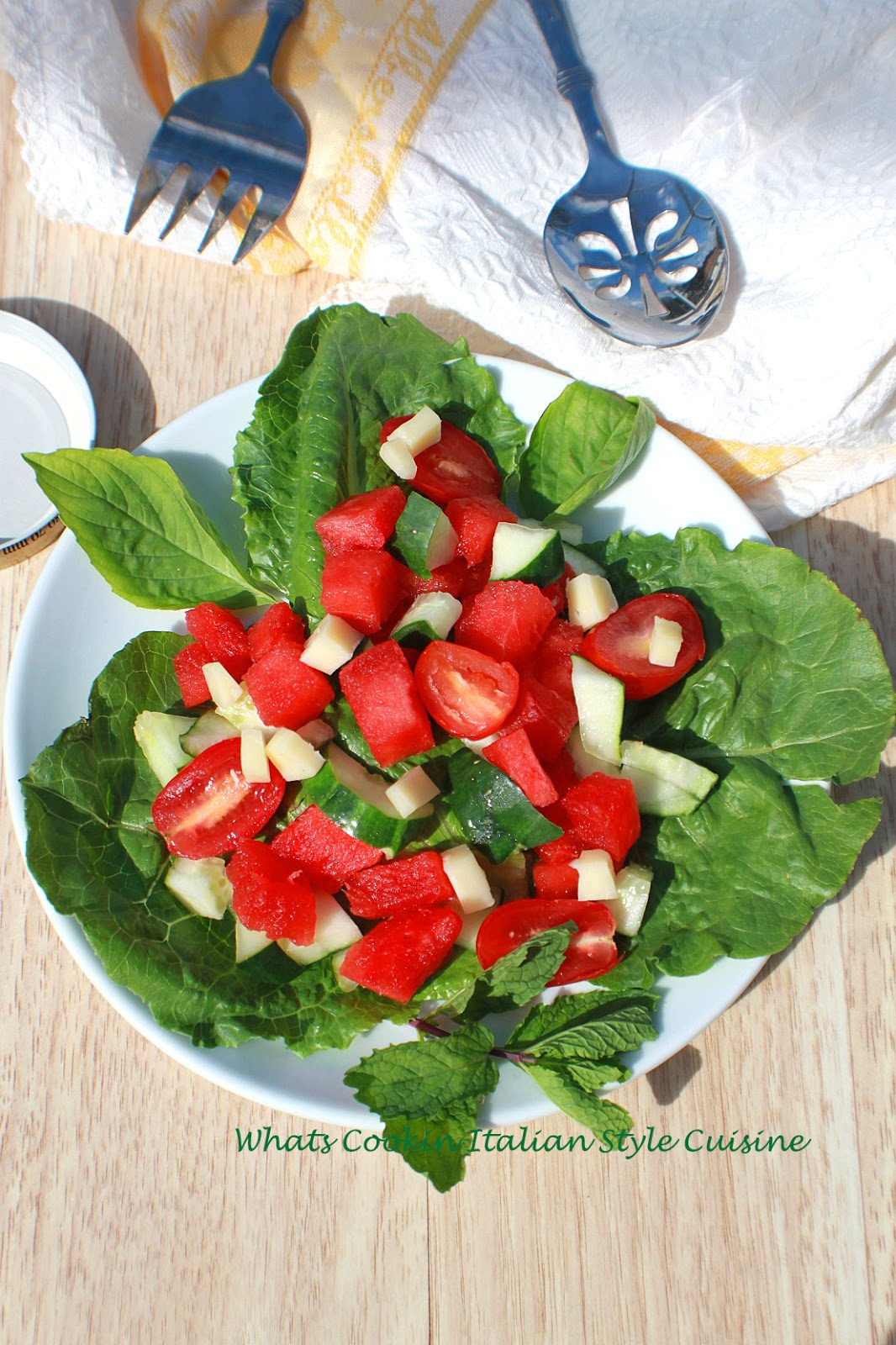 Watermelon Basil Salad is fresh watermelon on a bed of fresh greens, fresh vegetables and perfect for summer diet food