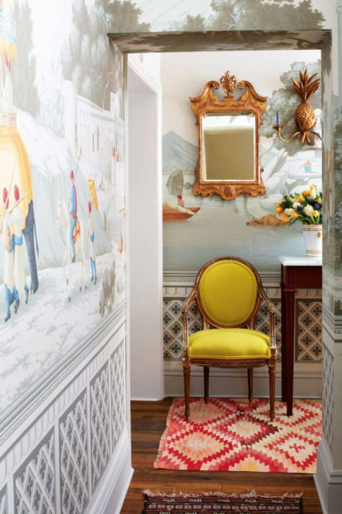 Early Views of India paper by De Gournay. Antique armchair, from Birgit Israel, and mirror, from Jamb London