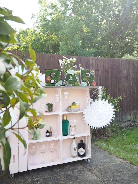 DIY tutorial for an outdoor bar using wooden crates, plus artificial grass bar letters to decorate. Perfect for summer BBQ's or garden parties.