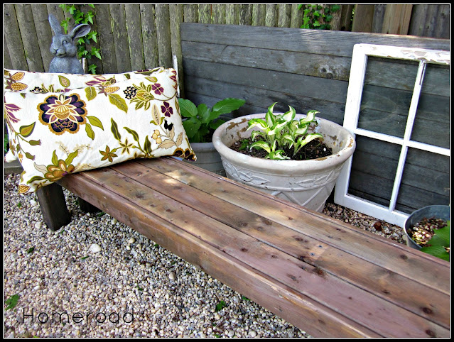 Garden bench with pillow