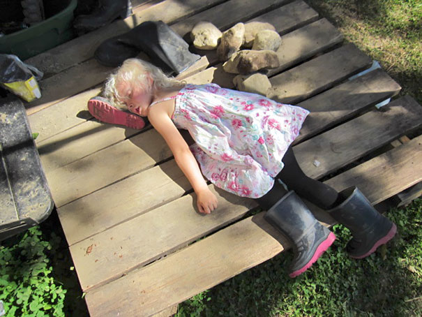 15+ Hilarious Pics That Prove Kids Can Sleep Anywhere - Napping On A A Rubber Boot