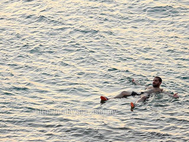 Dead Sea Floating Photo