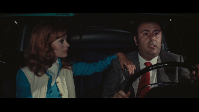 nervous guy in car with red haired woman