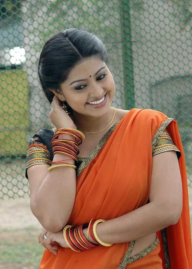Kollywood Actress Sneha Hip Navel Stills In Orange Saree