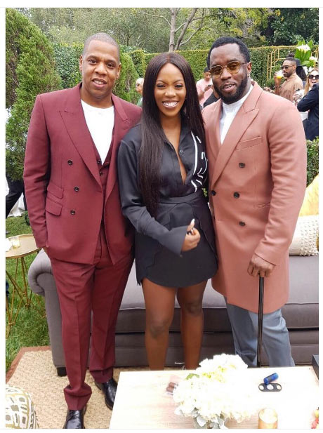 Tiwa Savage pictured with Jay-Z, P. Diddy, Kelly Rowland at pre-Grammy Award event