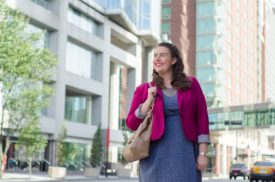 an outfit with a blue wool dress, a pink blazer, a taupe purse, and taupe wedges