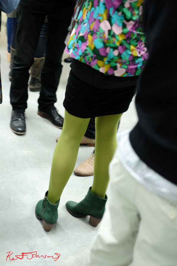 Vibrant coloursed jacket, black skirt light green tights and dark green suede low cut boots - winter colours.