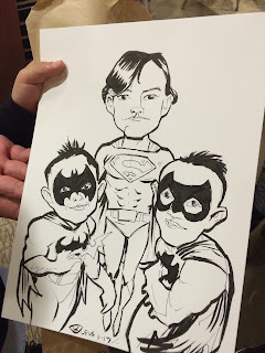 A Caricature of three young boys posed as Super Heros