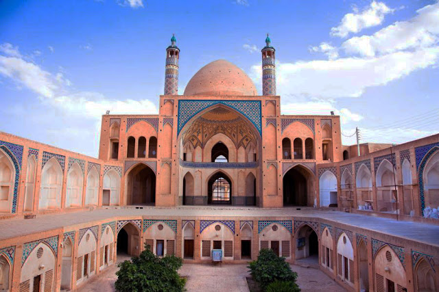The two story Agha Bozorg Mosque with brick works and tile works.