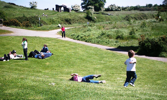 People resting on the grounds of Trim Castle, Meath, Ireland