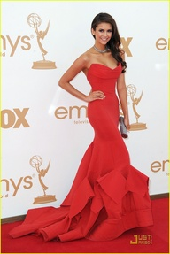 84cba0b2572 Here Nina Dobrev made an unforgettable fashion statement by stepping out to  the Emmys in 2011 in a Donna Karan stunning red gown. It s not over a top