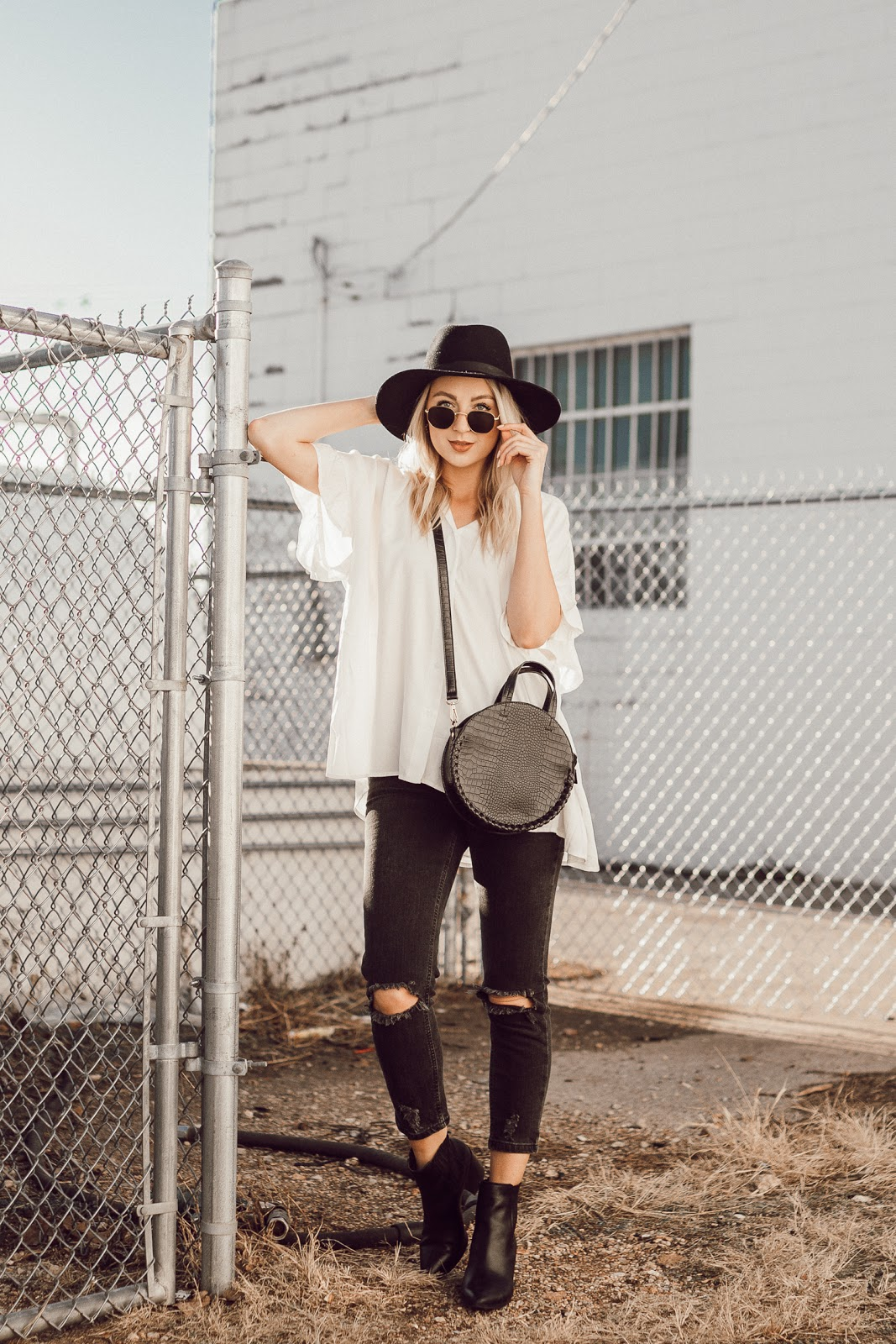 Easy, casual spring outfit with black distressed jeans