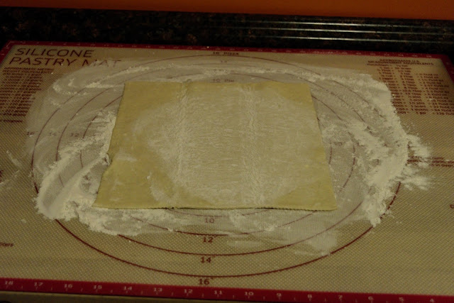 The puff pastry on the floured surface.