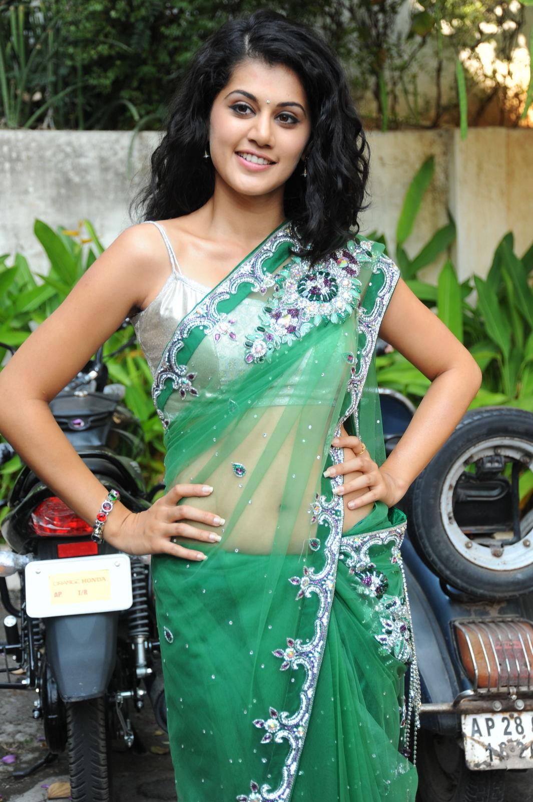 Glorious Tapsee cute in green saree