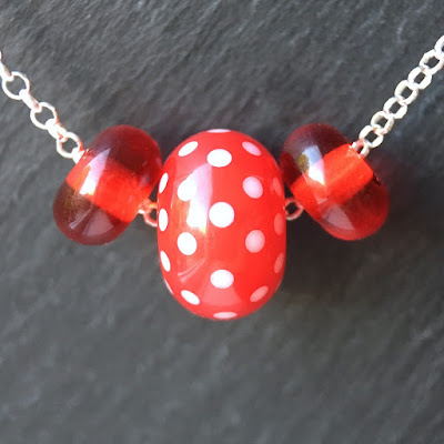 Lampwork glass and sterling silver necklace by Laura Sparling