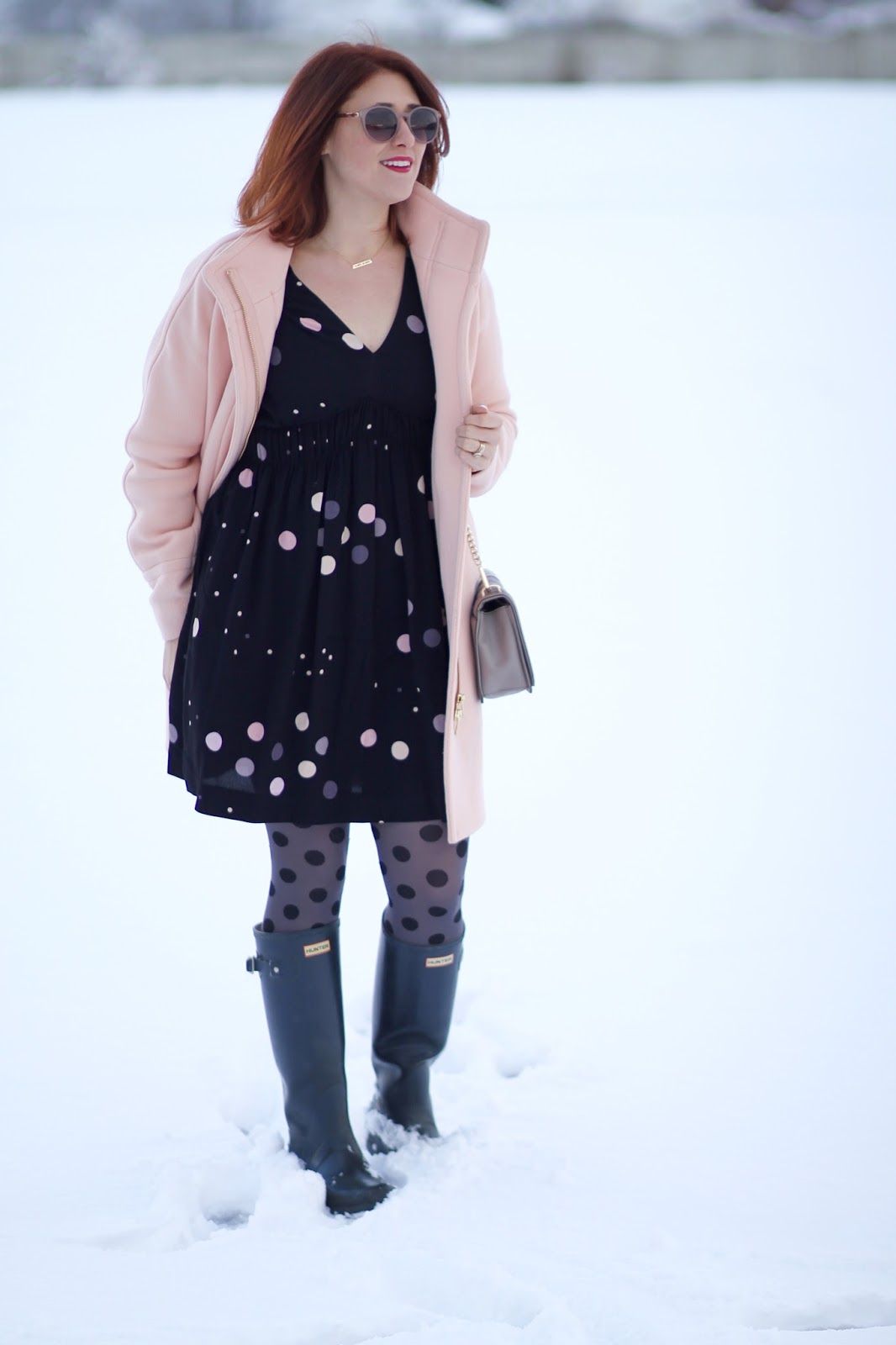 anthropologie felicity dress, polka dot tights, cocoon coat in pale ginger, red hair and navy hunter boots make a casual and cute affordable outfit for work or teacher