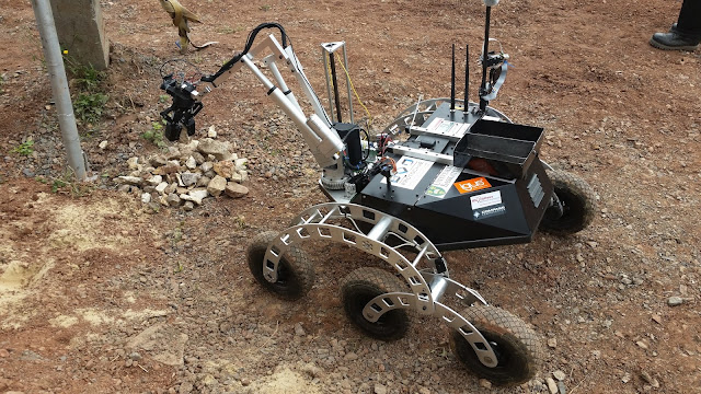 University of Saskatchewan's rover picking up a rock for the sample task during the ERC competition. Credit: USST