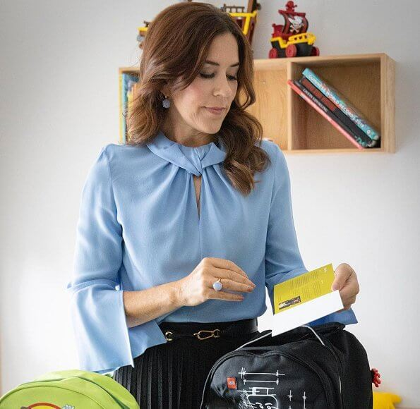 Crown Princess Mary wore Victoria Beckham flare sleeve knot blouse, and pleated midi skirt. Ole Lynggaard Frost earrings