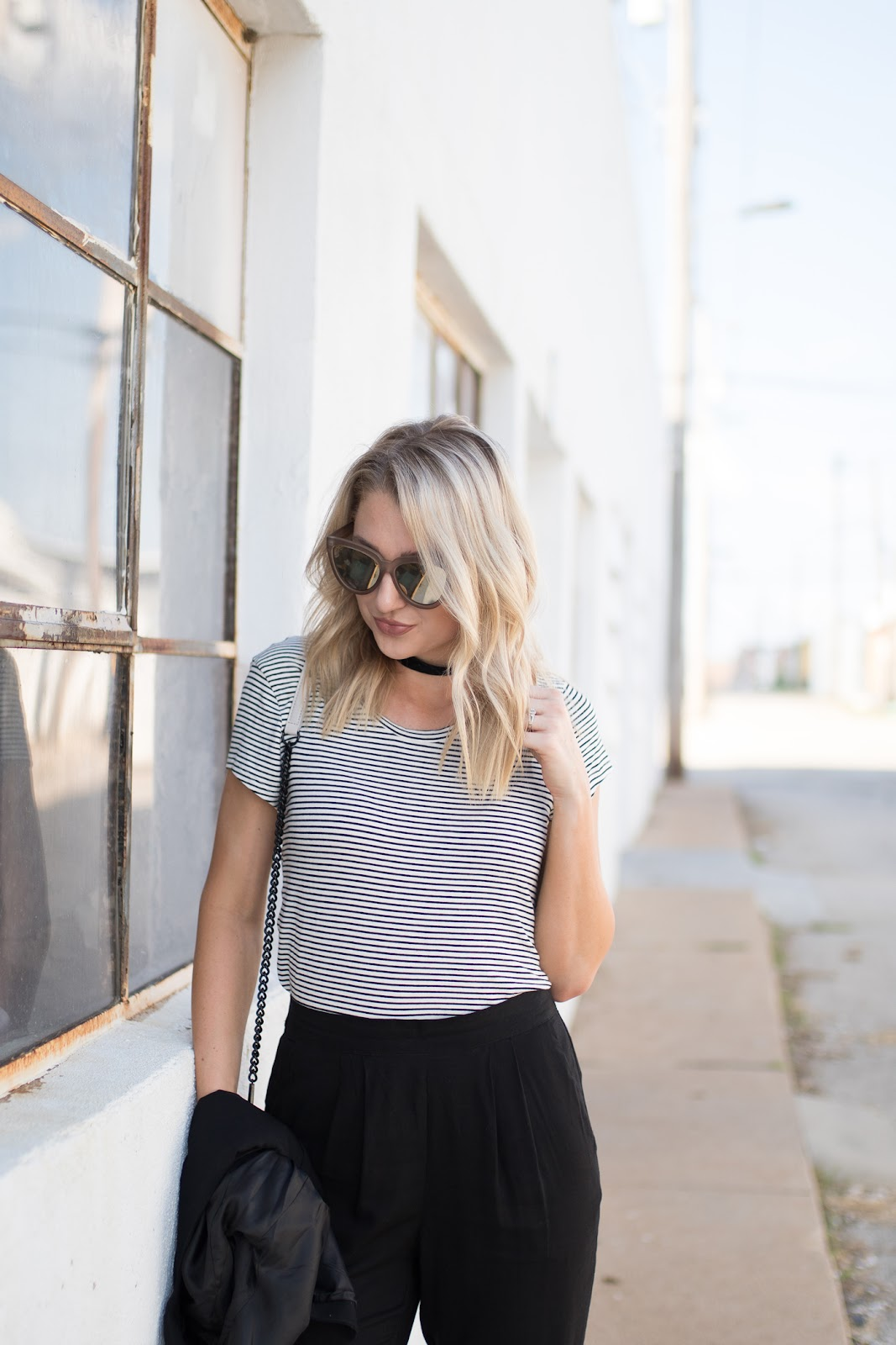 Striped tee tucked into black trousers