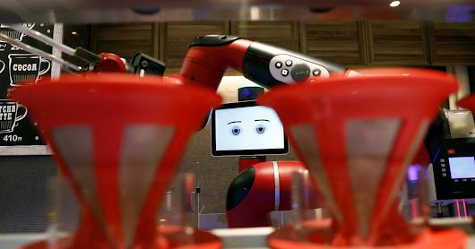 Robot coffee barista serve at travel agency in Tokyo coffee shop