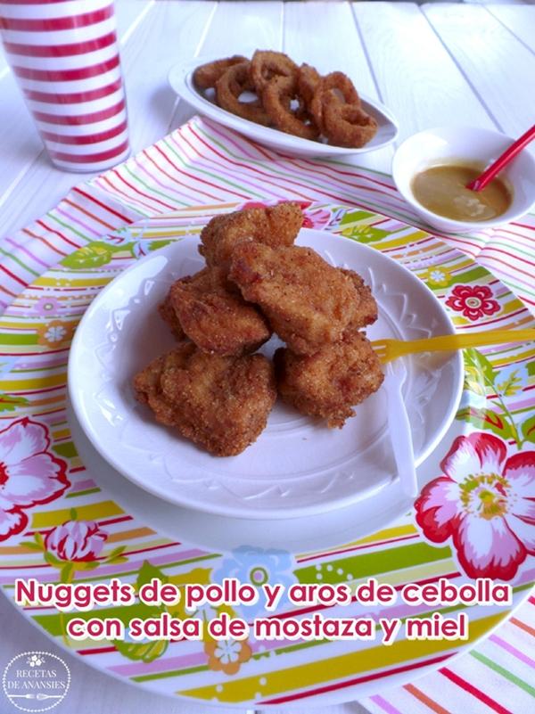 Nuggets de pollo y aros de cebolla con salsa de mostaza y miel