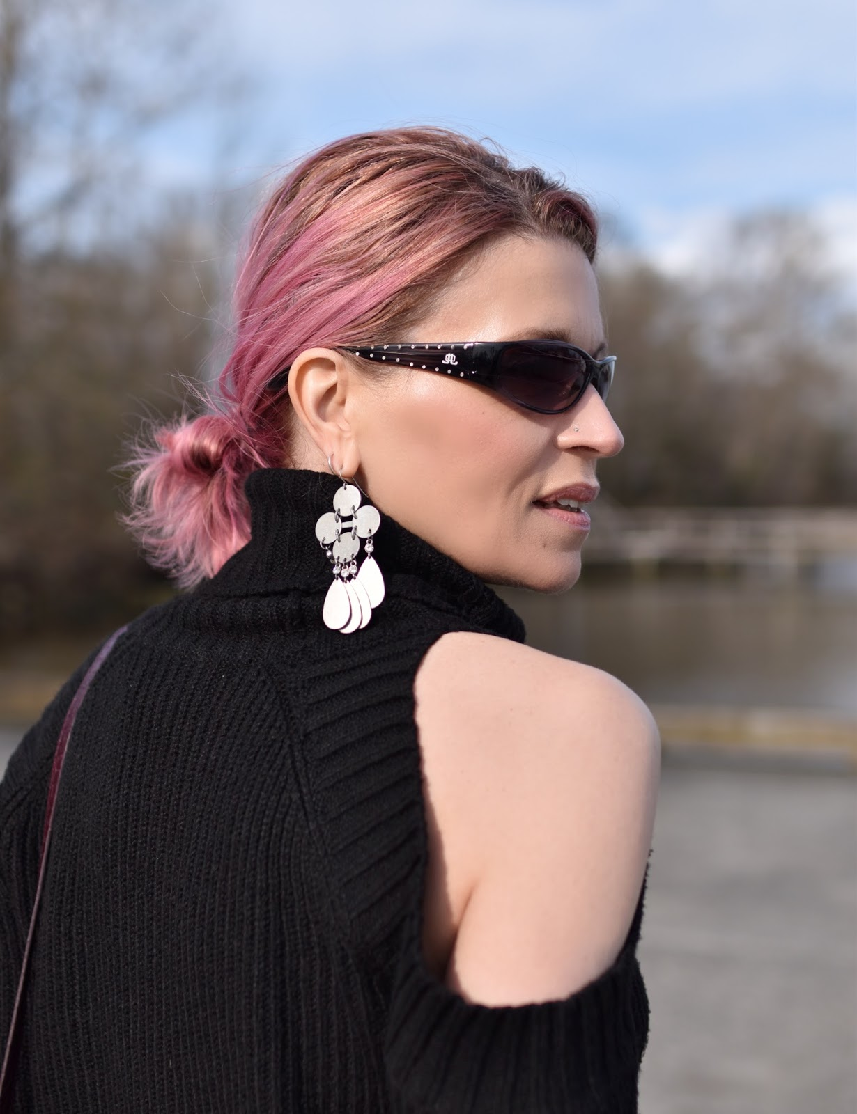 Monika Faulkner outfit inspiration - cold-shoulder sweater, chandelier earring, sunglasses, pink hair