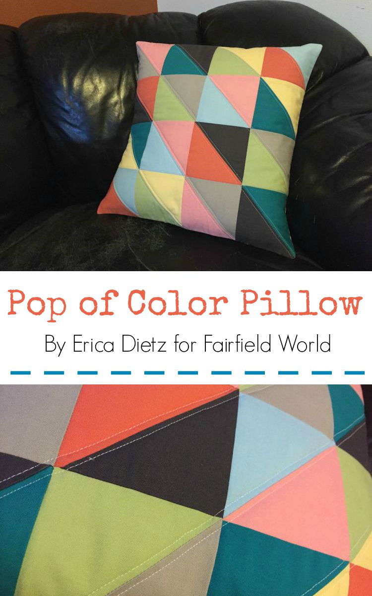 The pop of color pillow made with colorful half square triangle will brighten up any room
