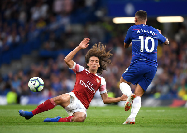 Matteo Guendouzi of Arsenal goes down whilst under pressure from Eden Hazard of Chelsea during the Premier League match between Chelsea FC and Arsenal FC at Stamford Bridge on August 18, 2018 in London, United Kingdom.