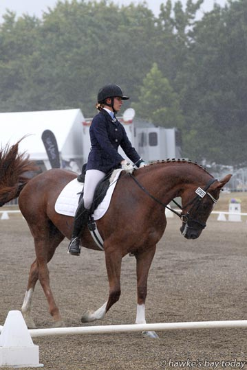 Irina Smith, Cambridge, on Affaire D'Amour, dressage in the rain, wet weather, at the Horse of the Year, at Hawke's Bay Showgrounds, Hastings. photograph