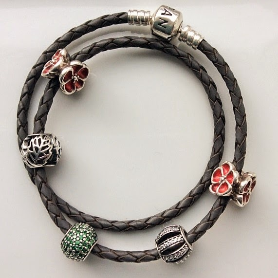 grey leather Pandora bracelet with green, red and openwork charms