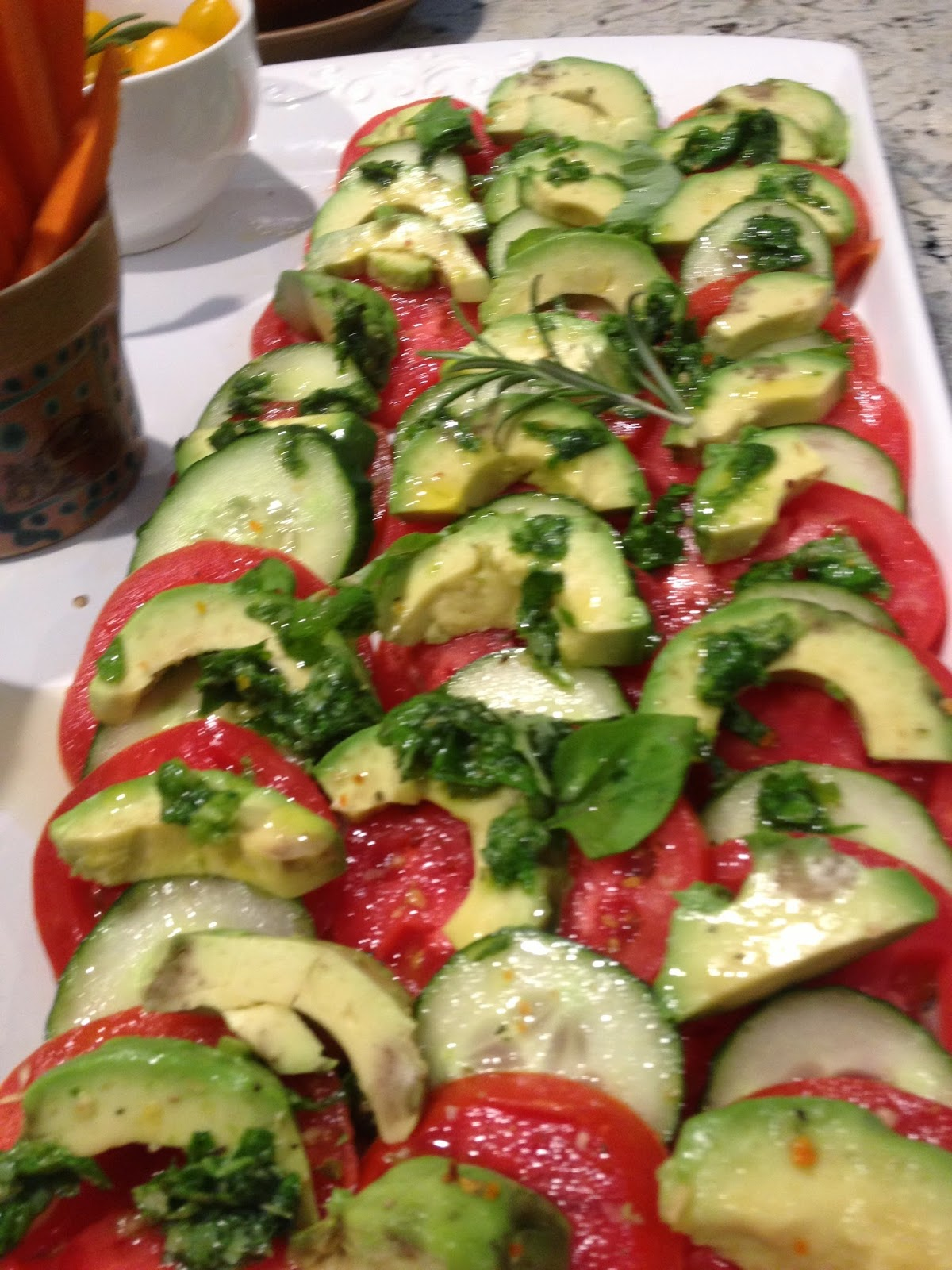 avocado tomatoes and basil on a rectangular plate