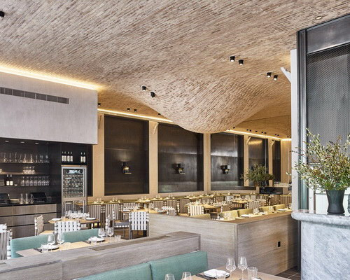 Tinuku.com Design interior Fucina restaurant with two bells brick roof dripped by Andy Martin Architects
