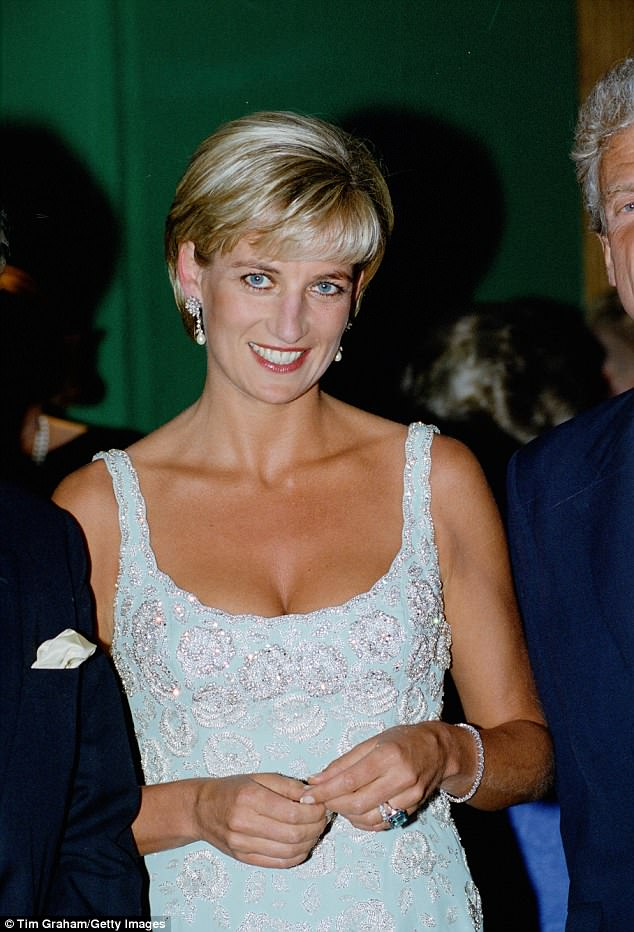 Lady Diana seen wearing the famous aquamarine ring which Meghan wore for her wedding reception
