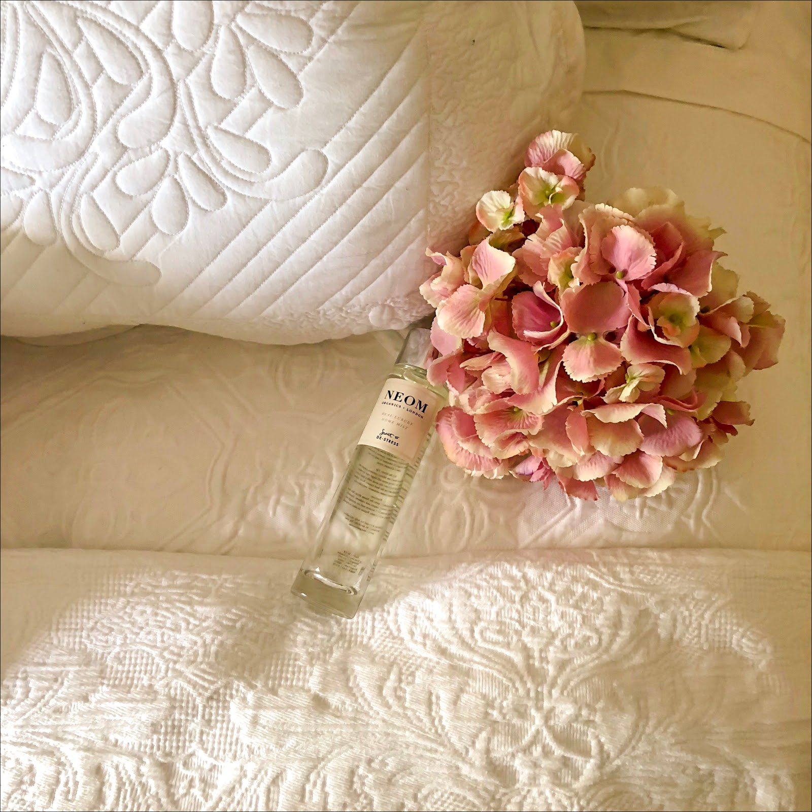 my midlife fashion, marks and spencer, marks and spencer neoms perfect nights sleep pillow mist, marks and spencer trapunto cushion, marks and spencer pure cotton floral matelasse bedding