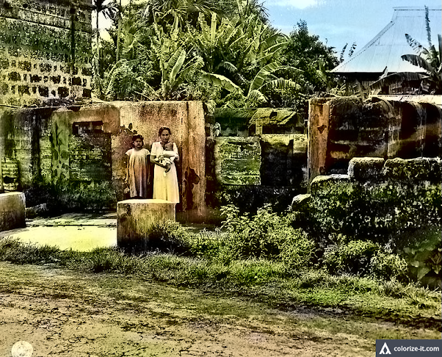 A citizen of San Jose, Batangas beside burned home 1945.  Image source:  United States National Archives.