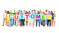 A group of people holding up the words Customer