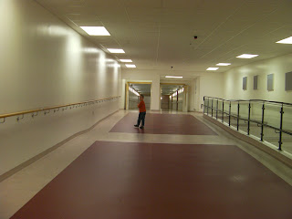 connecting corridor inside giant hospital