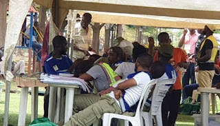 NYSC members serving as ad-hoc officials at a polling unit in Abuja sleeping on duty as voters werent turning out to vote.