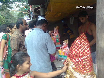 People purchasing Ganpati idols during Ganesh Chaturthi festival