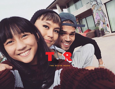 Chris Brown spotted at Disney Land holding hands with his rumored boo, singer Agnez Mo (photos)