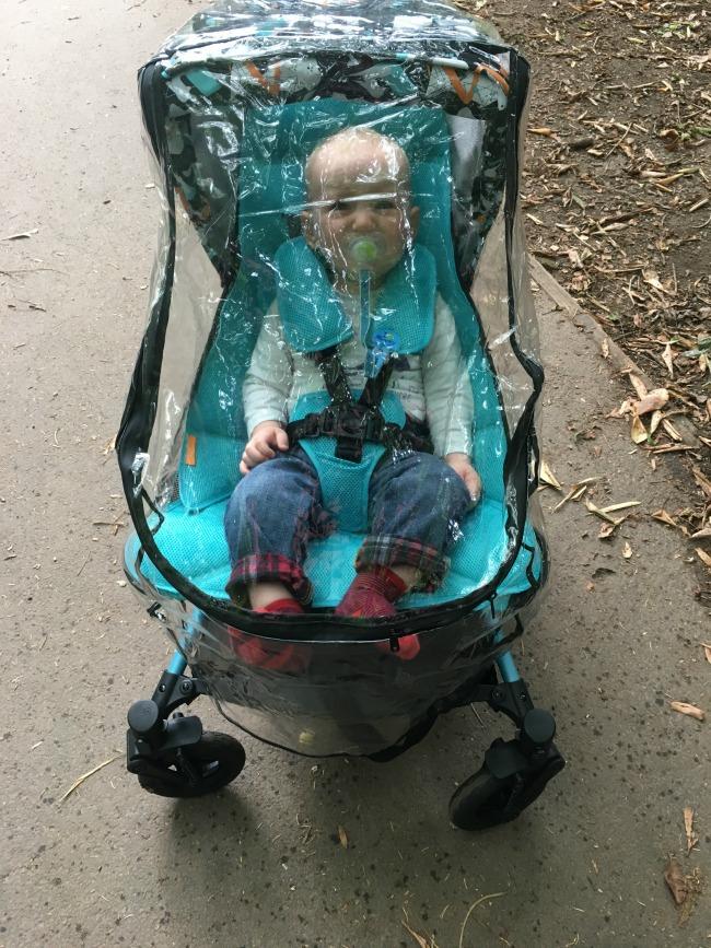 baby-under-rain-cover-sat-in-Micralite-Festival-Fastfold-Stroller