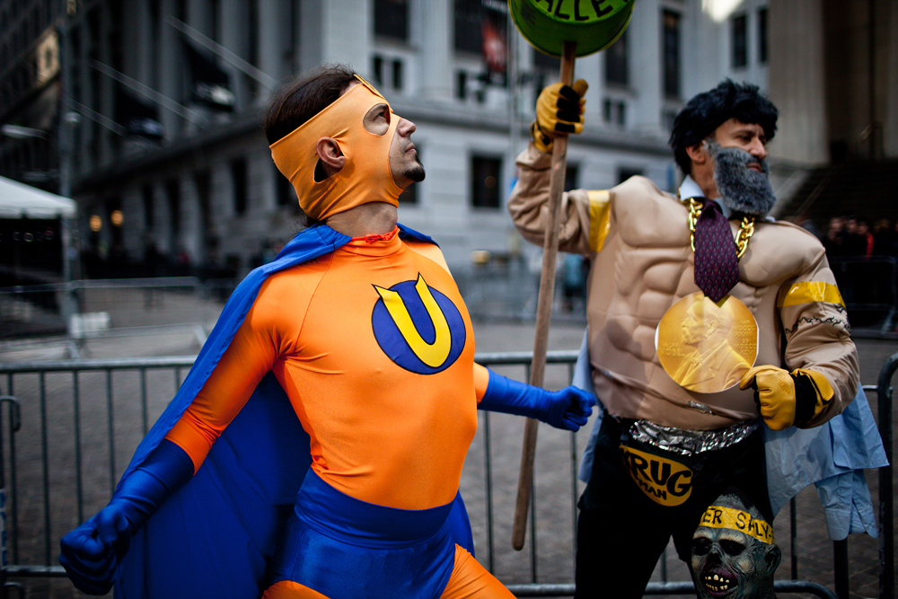Gan Golan, left, author of Unemployed Man, poses as the title character from his graphic novel and Robert Segal poses as Krug Man for a superheroes march to the New York Stock Exchange on Halloween.