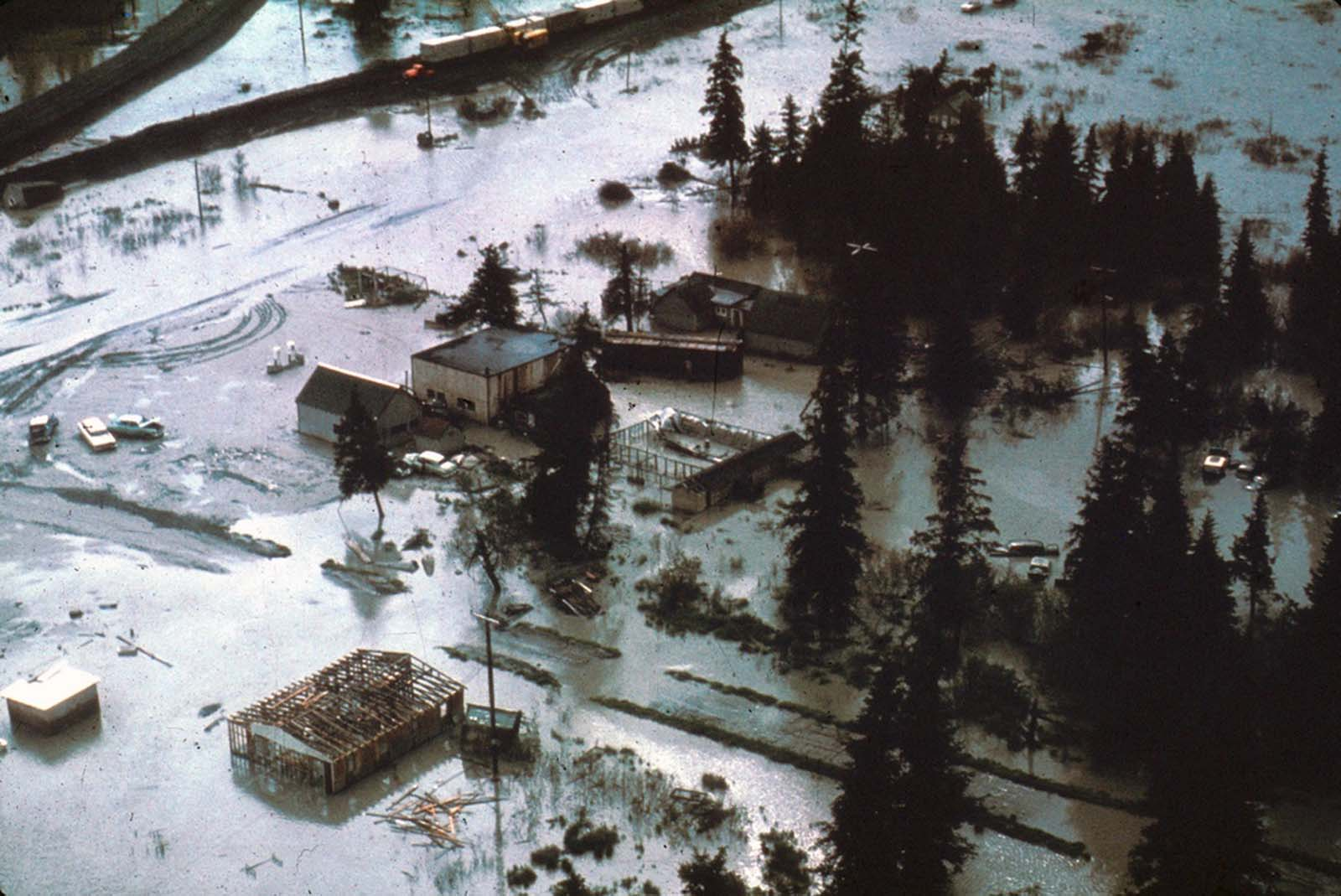 The village of Portage, at the head of Turnagain Arm, flooded at high tide as a result of 6 feet of tectonic subsidence during the earthquake.