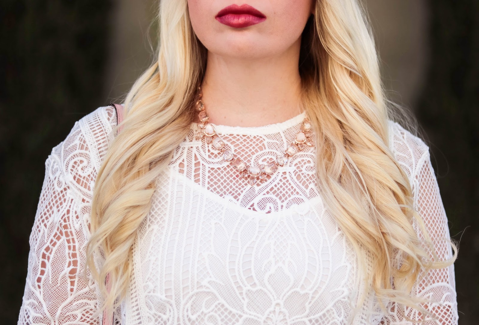Elizabeth Hugen of Lizzie in Lace styles a white feminine Chicwish dress