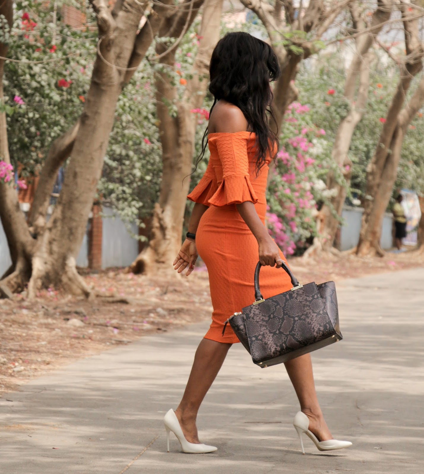 THE FLYGERIAN - Henri Bendel Snake Print Bag from The Flygerian and Orange off shoulder dress from Kitau and Boohoo court shoes