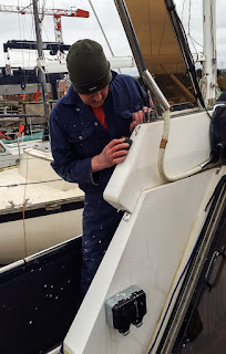 Photo of sanding a gelcoat repair