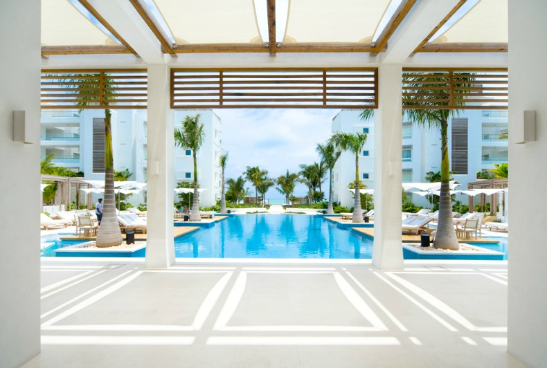 Cool blues and bright whites with touches of natural wicker can been seen throughout the resort.